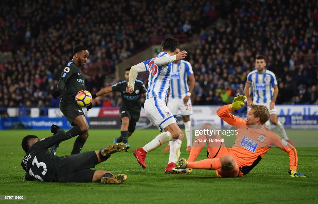 Raheem Sterling of Manchester City scores the 2nd Manchester City goal during the Premier League match between Huddersfield Town and Manchester City at John Smith's Stadium on November 26, 2017 in Huddersfield, England.