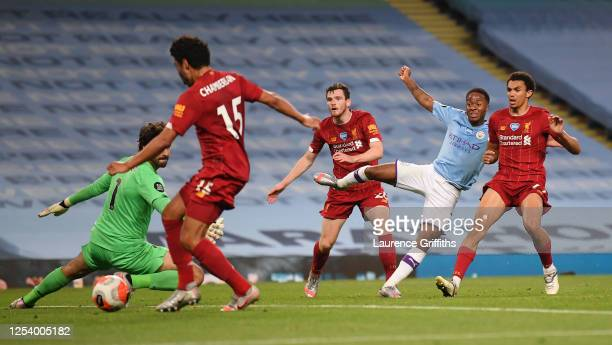 Raheem Sterling of Manchester City scores the fourth goal as it is deflected off Alex Oxlade-Chamberlain during the Premier League match between...
