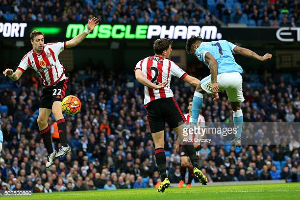 Raheem Sterling of Manchester City scores the opening goal with a header during the Barclays Premier League match between Manchester City and...