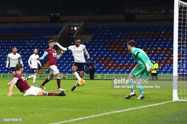 Raheem Sterling of Manchester City scores their side's second goal past Nick Pope of Burnley whilst under pressure from James Tarkowski of Burnley...