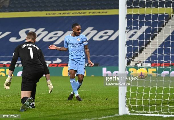 Raheem Sterling of Manchester City scores their team's fifth goal past Sam Johnstone of West Bromwich Albion during the Premier League match between...