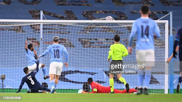 Raheem Sterling of Manchester City scores their team's third goal during the UEFA Champions League Group C stage match between Manchester City and...