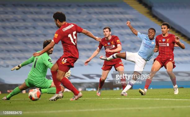 Raheem Sterling of Manchester City shoots and it is deflected in by Alex Oxlade-Chamberlain of Liverpool for a own goal and Manchester City fourth...