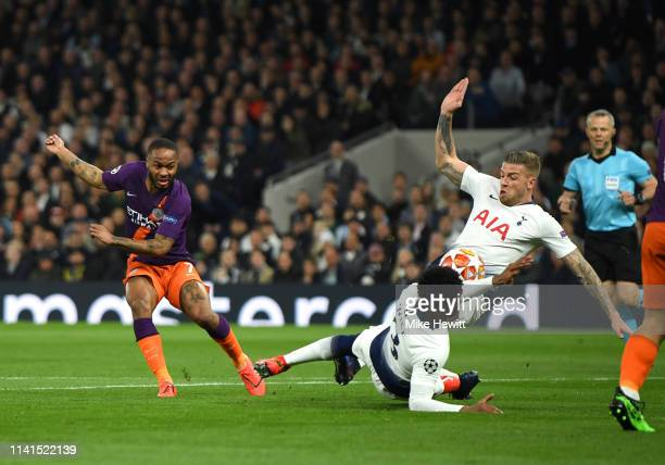 Raheem Sterling of Manchester City shoots as Danny Rose of Tottenham Hotspur attempts to block it with his arm that latter leads to a penalty during...
