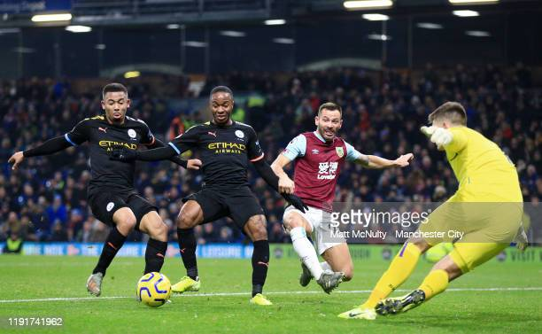 Raheem Sterling of Manchester City shoots as Nick Pope of Burnley attempts to save during the Premier League match between Burnley FC and Manchester...