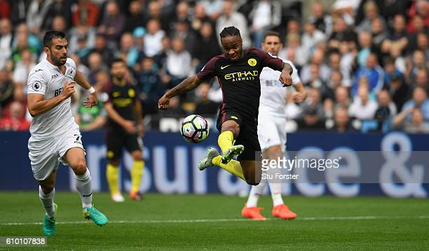 Raheem Sterling of Manchester City shoots at goal during the Premier League match between Swansea City and Manchester City at the Liberty Stadium on...