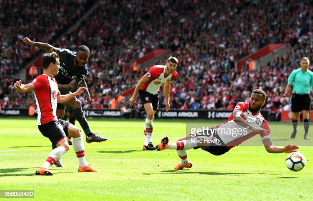 Raheem Sterling of Manchester City shoots but is blocked by Ryan Bertrand of Southampton during the Premier League match between Southampton and...