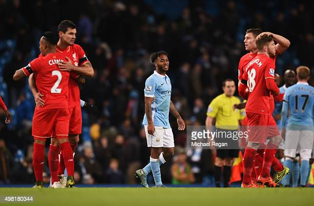 Raheem Sterling of Manchester City shows his frustration while Liverpool players celebrate their 41 win in the Barclays Premier League match between...