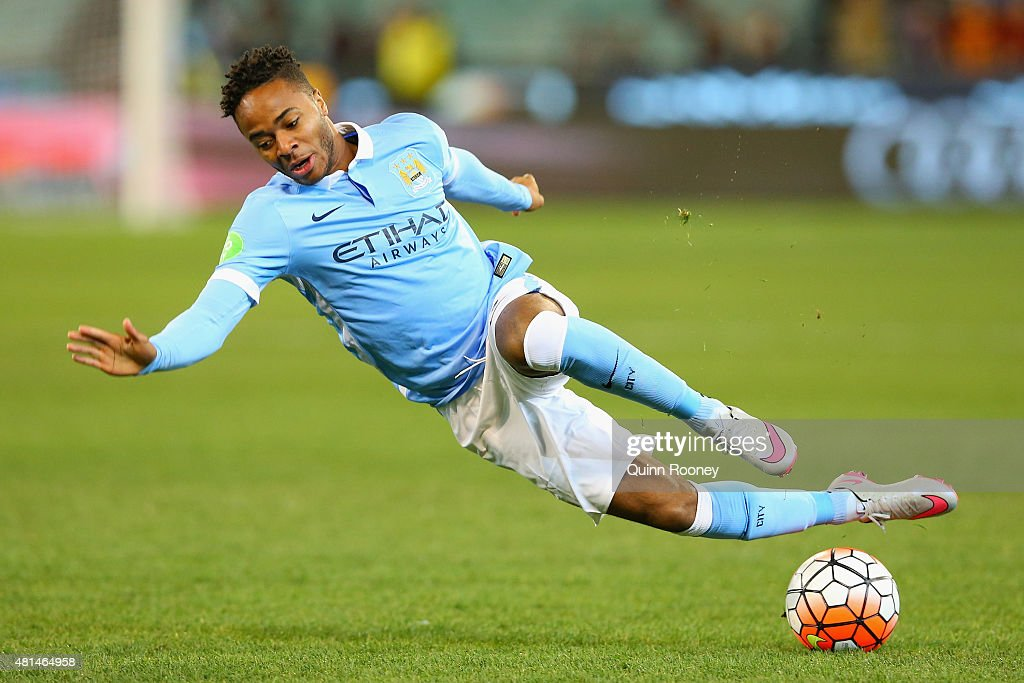 Raheem Sterling of Manchester City slips over whilst looking to pass the ball during the International Champions Cup friendly match between Manchester City and AS Roma at the Melbourne Cricket Ground on July 21, 2015 in Melbourne, Australia.
