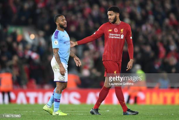 Raheem Sterling of Manchester City speaks with Joe Gomez of Liverpool following the Premier League match between Liverpool FC and Manchester City at...