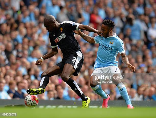 Raheem Sterling of Manchester City tackles Allan Nyom of Watford during the Barclays Premier League match between Manchester City and Watford at the...