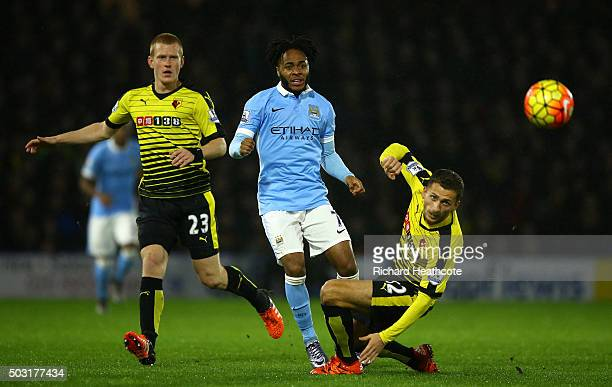 Raheem Sterling of Manchester City takes a shot at goal under pressure from Almen Abdi of Watford during the Barclays Premier League match between...