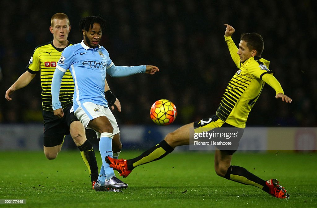 Raheem Sterling of Manchester City takes a shot at goal under pressure from Almen Abdi of Watford during the Barclays Premier League match between Watford and Manchester City at Vicarage Road on January 2, 2016 in Watford, England.
