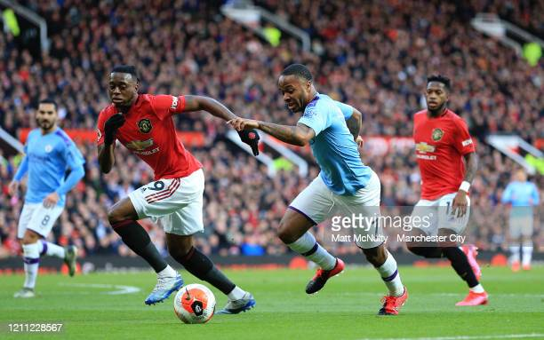 Raheem Sterling of Manchester City takes on Aaron WanBissaka of Manchester United during the Premier League match between Manchester United and...
