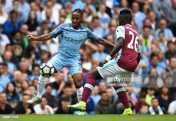 Raheem Sterling of Manchester City takes on Arthur Masuaku of West Ham United during the Premier League match between Manchester City and West Ham...