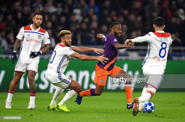 Raheem Sterling of Manchester City takes on Fernando Marcal and Houssem Aouar of Olympique Lyonnais during the UEFA Champions League Group F match...