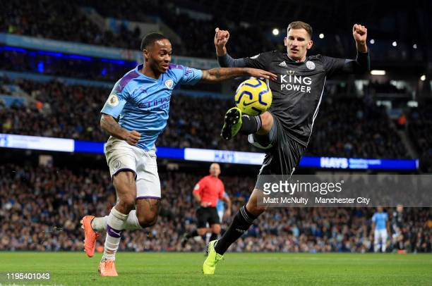 Raheem Sterling of Manchester City takes on Marc Albrighton of Leicester City during the Premier League match between Manchester City and Leicester...
