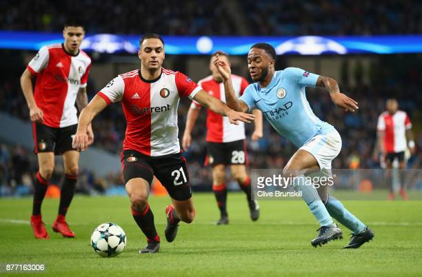 Raheem Sterling of Manchester City takes on Sofyan Amrabat of Feyenoord during the UEFA Champions League group F match between Manchester City and...