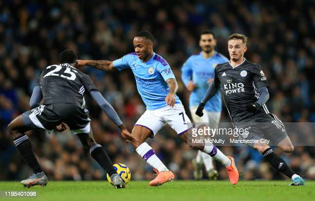 Raheem Sterling of Manchester City takes on Wilfred Ndidi of Leicester City during the Premier League match between Manchester City and Leicester...