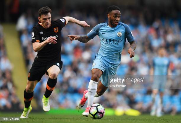 Raheem Sterling of Manchester City takes the ball away from Andrew Robertson of Hull City during the Premier League match between Manchester City and...