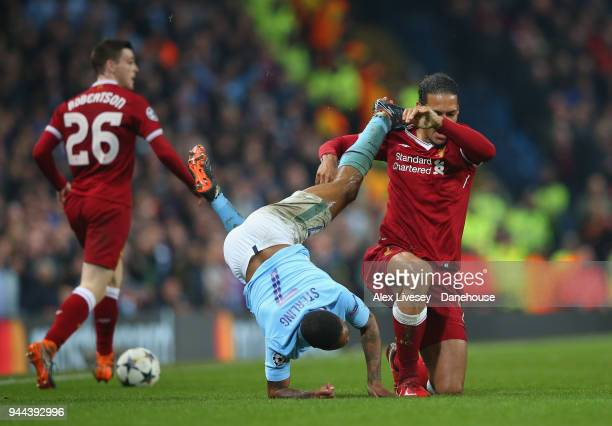Raheem Sterling of Manchester City tussles with Virgil Van Dijk of Liverpool during UEFA Champions League Quarter Final Second Leg match between...
