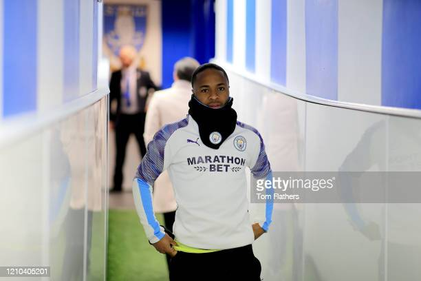 Raheem Sterling of Manchester City walks out to warm up prior to the FA Cup Fifth Round match between Sheffield Wednesday and Manchester City at...