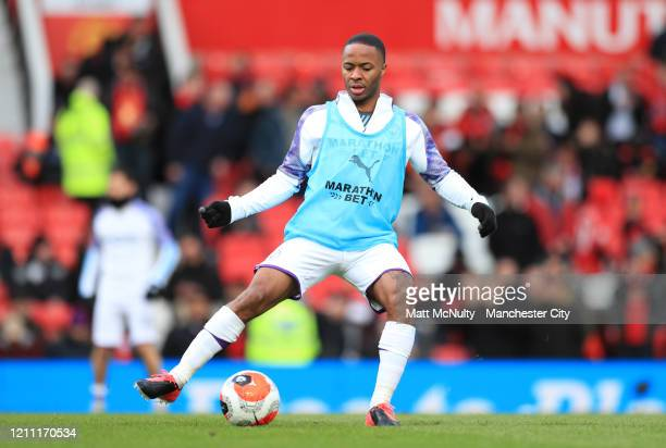 Raheem Sterling of Manchester City warms up ahead of the Premier League match between Manchester United and Manchester City at Old Trafford on March...