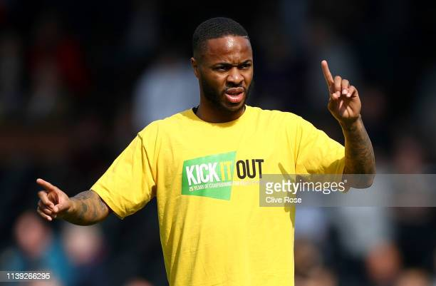 Raheem Sterling of Manchester City warms up while wearing a Kick It Out racism shirt prior to the Premier League match between Fulham FC and...