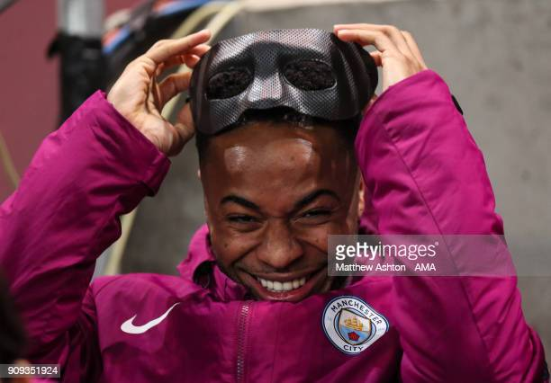 Raheem Sterling of Manchester City wearing a face mask from Eliaquim Mangala of Manchester City during the Carabao Cup SemiFinal Second Leg between...