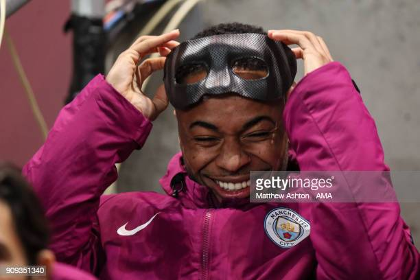 Raheem Sterling of Manchester City wears a face mask from Eliaquim Mangala of Manchester City during the Carabao Cup SemiFinal Second Leg between...