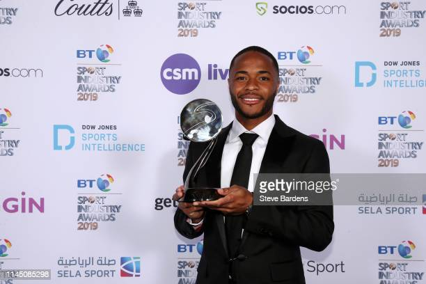 Raheem Sterling poses with The Integrity and Impact Award found by Dow Jones Intelligence at the BT Sport Industry Awards 2019 at Battersea Evolution...