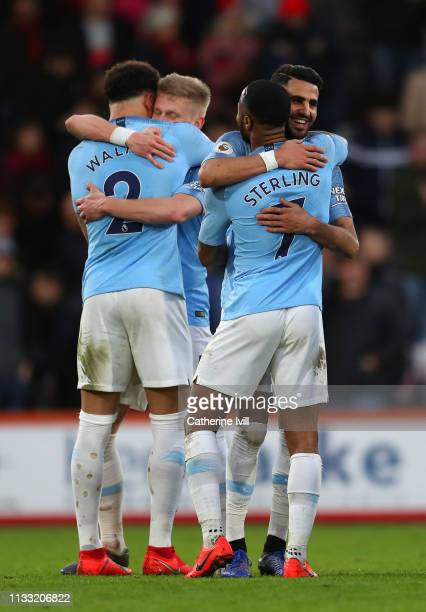 Raheem Sterling Riyad Mahrez Kyle Walker and Oleksandr Zinchenko of Manchester City celebrate at the final whistle of the Premier League match...