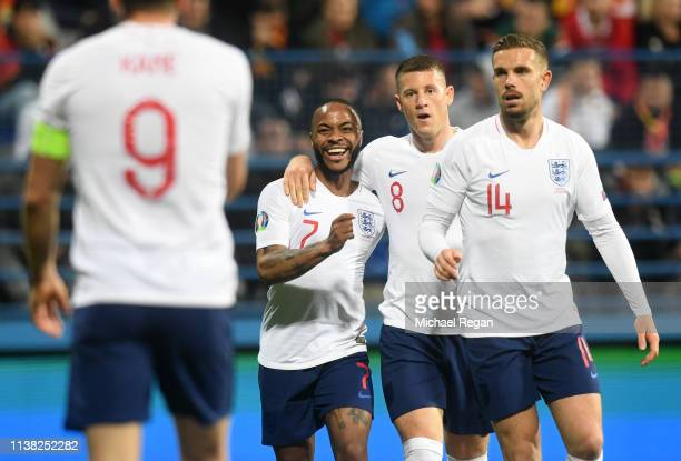 Raheem Sterling, Ross Barkley and Jordan Henderson of England congratulate Harry Kane as scores his team's fourth goal during the 2020 UEFA European...