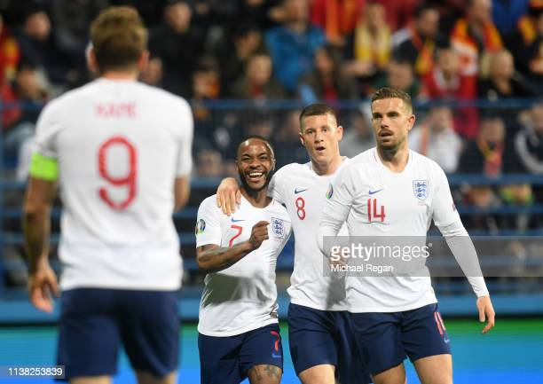 Raheem Sterling Ross Barkley and Jordan Henderson of England congratulate Harry Kane as scores his team's fourth goal during the 2020 UEFA European...