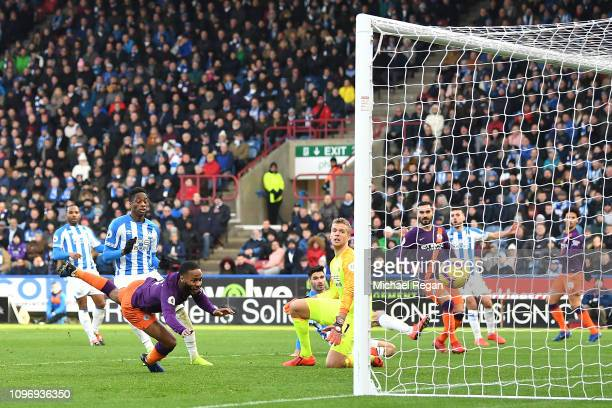 Raheem Sterling scores his sides second goal during the Premier League match between Huddersfield Town and Manchester City at John Smith's Stadium on...