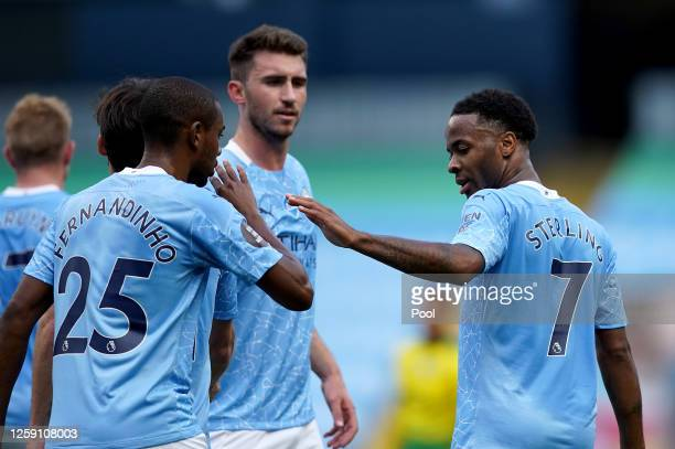 Raheem Sterling shakes hands with David Silva both of Manchester City during the Premier League match between Manchester City and Norwich City at...
