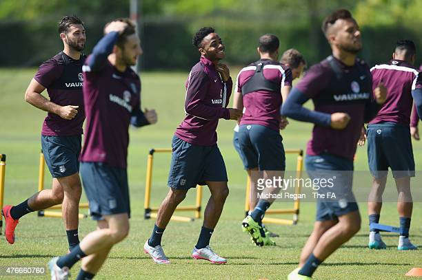 Raheem Sterling smiles during the England training session on June 11, 2015 in St Albans, England.
