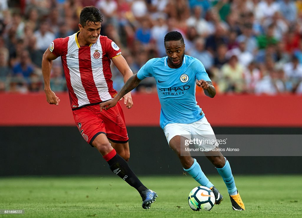 Raheen Sterling (R) of Manchester City is closed down by Bernardo of Girona during the pre-season friendly match between Girona and Manchester City at Municipal de Montilivi Stadium on August 15, 2017 in Girona, Spain.