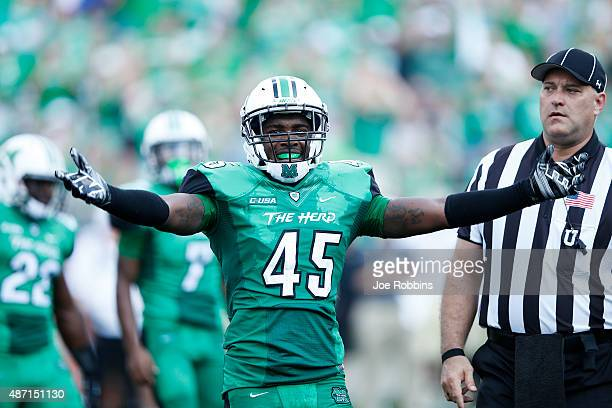 Raheim Huskey of the Marshall Thundering Herd celebrates in the first half against the Purdue Boilermakers at Joan C Edwards Stadium on September 6...