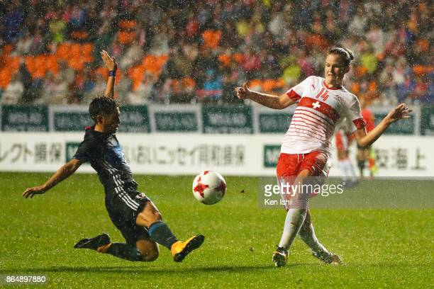 Rahel Kiwic of Switzerland and Kumi Yokoyama of Japan compete for the ball during the international friendly match between Japan and Switzerland at...