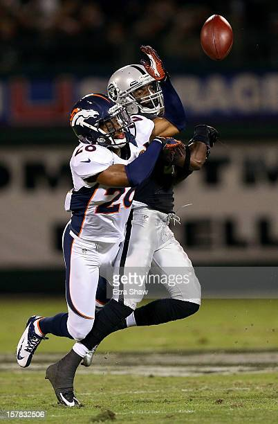 Rahim Moore of the Denver Broncos breaks up a pass intended for Denarius Moore of the Oakland Raiders at OaklandAlameda County Coliseum on December 6...