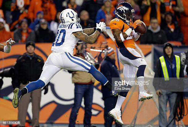 Rahim Moore of the Denver Broncos intercepts a pass intended for Donte Moncrief of the Indianapolis Colts during a 2015 AFC Divisional Playoff game...