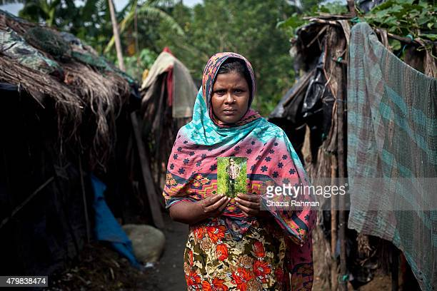Rahima Khartoum holds a photograph of her son 14 year old trafficking victim Din Mohammad July 4 2015 in Shamlapur Bangladesh 3 months ago Mohammad...
