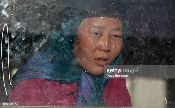 Rahima looks out the window of her room at a women's shelter October 8 2010 in Bamiyan Afghanistan Rahima from Maydan Wardak was a child bride forced...