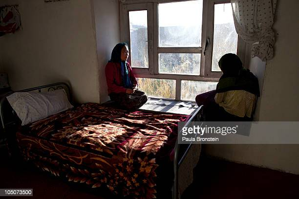 Rahima looks out the window of her room with another battered woman at a women's shelter October 8 2010 in Bamiyan Afghanistan Rahima from Maydan...