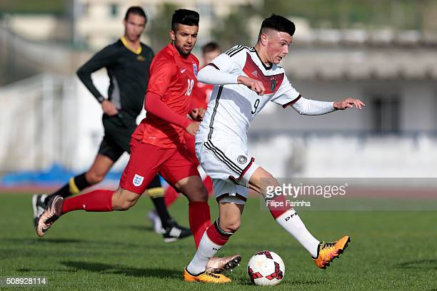 Rahis Nabi of England challenges Renat Dadashov of Germany during the UEFA Under17 match between U17 England v U17 Germany on February 7 2016 in...