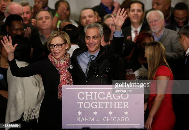 Rahm Emanuel waves to supporters with his wife Amy Rule during his victory speech after being reelected Mayor of Chicago at his election night rally...
