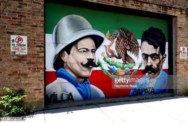 Rahmaan 'Statik' Barnes' 'Pancho Villa and Emiliano Zapata' mural is displayed in the Pilsen neighborhood in Chicago Illinois on June 7 2019...