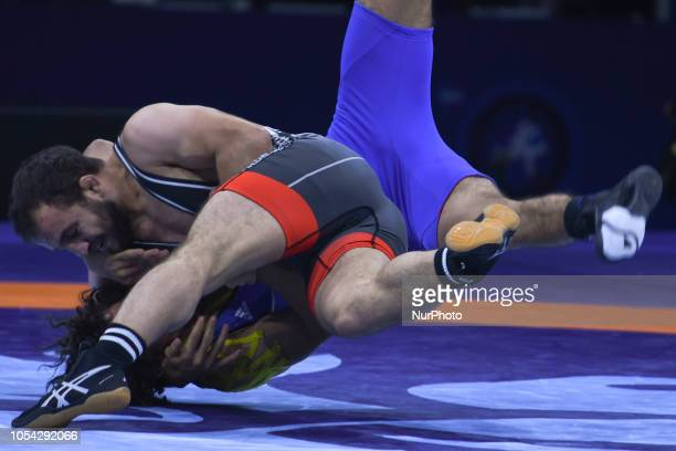 Rahman Bilici of Turkey against Hassan Hassan Ahmed Mohamed of Egypt during a Bronze medal fight in men's GreecoRoman wrestling 63kg category at the...