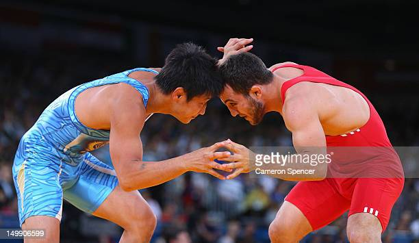 Rahman Bilici of Turkey competes with Ryutaro Matsumoto of Japan during their Men's Greco-Roman 60 kg Wrestling 1/8 Final bout on Day 10 of the...